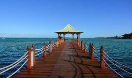 Seascape in Mahebourg, Mauritius. Mahebourg, Mauritius - Jan 3, 2017. View of a wooden bridge in Mahebourg, Mauritius. Mauritius, an Indian Ocean island nation Stock Image