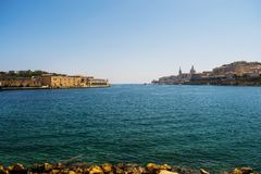 A seascape of Manoel Island and Valletta in Malta. With a calm Mediterranean sea during a Summer day Royalty Free Stock Photos