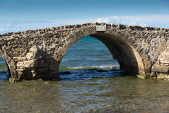 Seascape with medieval bridge in the water at Argassi beach, Zakynthos island Stock Photo