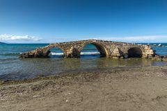 Seascape with medieval bridge in the water at Argassi beach, Zakynthos island, Greece. Amazing seascape with medieval bridge in the water at Argassi beach royalty free stock photo