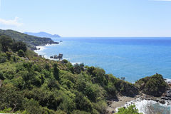 Seascape of Mediterranean coast with rocks and hills descending Royalty Free Stock Photos