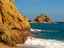 Seascape with the Mediterranean Sea and golden rocks on the beaches of Tossa de Mar. Spain Stock Photo