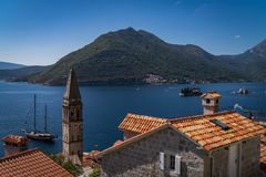Monastery on the island in Perast, Montenegro. Seascape, Monastery on the island in Perast, Montenegro during sunny day Stock Photos