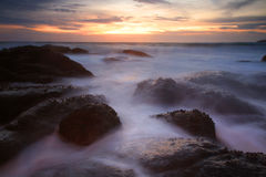 Seascape with motion water hitting rocks Royalty Free Stock Photo