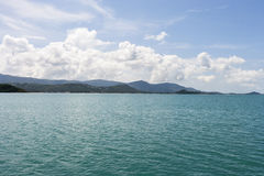 Seascape with mountains in the background, Koh Pha Ngan, Thailand Stock Photos