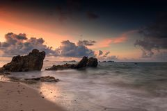 Seascape with natural stone arch at dawn. Motion Seascape with natural stone arch at dawn with twilight sky in Rayong beach, Thailand. Big stopper Long Exposure Stock Images