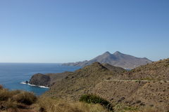 Seascape near Almeria. Mountains diving into the ocean in Los Escullos, Almeria, Spain Stock Images