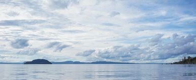 Seascape of New Zealand. Blue sea at early morning in North Island of New Zealand Royalty Free Stock Images
