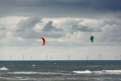 Seascape, North sea by Dutch coast with wind mills and kite surf. Ers in winter stock photos