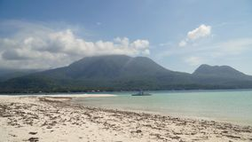 Beautiful beach on tropical island.Camiguin, Philippines. Seascape ocean,mountains and beautiful beach paradise. Beach, sea, sand,wave. Tropical beach, blue sky Royalty Free Stock Photography