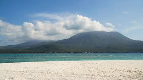Beautiful beach on tropical island.Camiguin, Philippines. Seascape ocean,mountains and beautiful beach paradise. Beach, sea, sand,wave. Tropical beach, blue sky Stock Photo