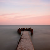 Seascape with old pier Royalty Free Stock Photo