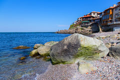 Seascape old town with rocks in the foreground Stock Photo