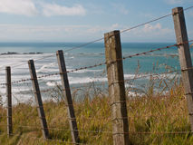 Seascape over fence Royalty Free Stock Photography