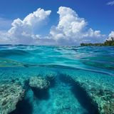 Seascape over under sea cloudy sky rocky seabed royalty free stock photos