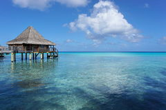 Seascape with overwater bungalow in the lagoon Stock Photos