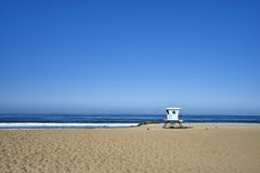 Seascape of pacific ocean, sand and waves; lifeguard station 7. Peaceful early morning walk on the beach near Ventura, California royalty free stock photo
