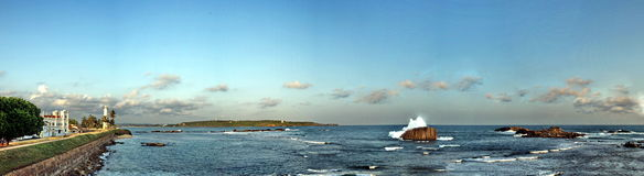 wide panorama exotic ocean city coast with big wave and rock Royalty Free Stock Image