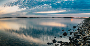 Seascape panorama with calm water and scenic clouds royalty free stock images