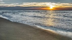 Seascape panorama of sea sunset with soft waves and clouds. Popular beach holiday destination Sunshine Coast Australia royalty free stock image