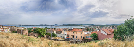 Seascape panorama of touristic town, Cunda Alibey Island, Ayvalik. It is a small island in the no. BALIKESIR, TURKEY - MAY 21 2016: Cityscape panorama of stock images
