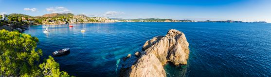 Seascape panorama view of the bay in Cala Fornells, beautiful seaside of Mallorca island, Spain. Idyllic island scenery, panorama view of bay with boats at Cala Stock Photos