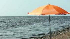 Seascape parasol on empty beach stock video footage