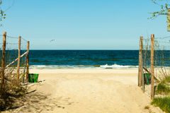 Seascape. Path to the sandy beach. Summer. Royalty Free Stock Image