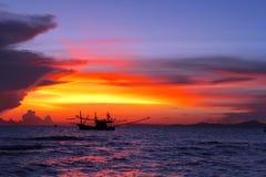 Seascape at Pattaya. Orange sunset and fishing boat at Pattaya beach, Thailand Royalty Free Stock Images