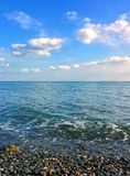 Seascape and pebble beach. Seascape, pebble beach and clouds Royalty Free Stock Images