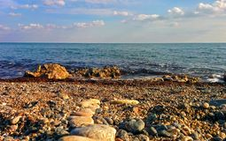 Seascape from pebble beach. Seascape with clouds and waves from pebble beach Stock Photography