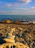 Seascape from pebble beach. Seascape with clouds and waves from pebble beach Royalty Free Stock Image