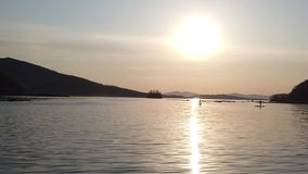 Seascape with people on the boards. Vladivostok, Russia stock footage