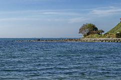 Seascape of pier for fishing in the Black Sea with larus, small house and tree at coast, ancient city Nessebar. Bulgaria, Europe stock images