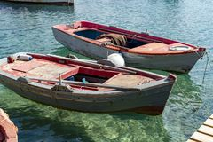 Seascape with pier, quiet sea harbor with clear transparent water and traditional greek fisher boats. Seascape with pier, quiet sea harbour with clear stock images