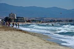 Seascape of the Poetto sandy beach  in Cagliari with people relaxing to the sun Royalty Free Stock Photography