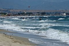 Seascape of the Poetto sandy beach  in Cagliari with people relaxing to the sun Stock Image