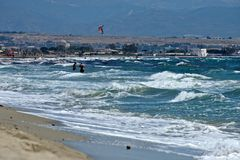 Seascape of the Poetto sandy beach  in Cagliari with people relaxing to the sun Royalty Free Stock Image