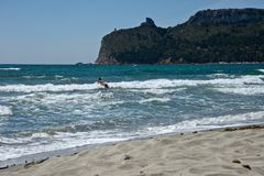 Seascape of the Poetto sandy beach  in Cagliari with a woman Stock Photos