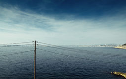 Seascape and power cables Stock Photography