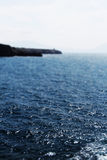 Seascape with a promontory, miniature style Stock Images
