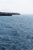 Seascape with a promontory, sunny day Stock Image