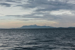 Seascape with Raining Cloud and Mountain at Dusk of George Town, Penang, Malaysia Royalty Free Stock Photos