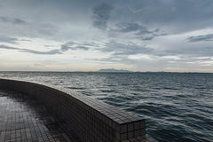Seascape with Raining Cloud and Mountain at Dusk of George Town, Penang, Malaysia Stock Photos