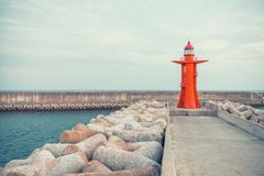 View on red color lighthouse at Jeju Island - South Korea Stock Images