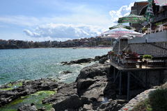 Seascape, restaurants and cafes on the shore Stock Image