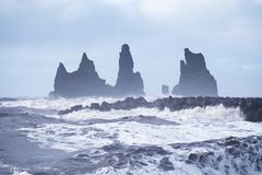 Seascape of Reynisdrangar cliffs in the Atlantic ocean. south Iceland. Vic village Royalty Free Stock Photography