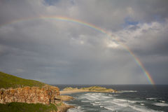 Seascape at Robberg South Africa. Seascape with rainbow at Robberg, Plettenberg Bay, Garden Route, South Africa Stock Photos
