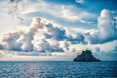 Seascape with rock in blue sea water on cloudy sky in gustavia, st.barts. Summer vacation on tropical island. Wild. Nature and environment, ecology. Holiday stock photo