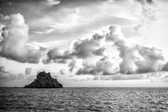 Seascape with rock in blue sea water on cloudy sky in gustavia, st.barts. Summer vacation on tropical island. Wild. Nature and environment, ecology. Holiday stock photos